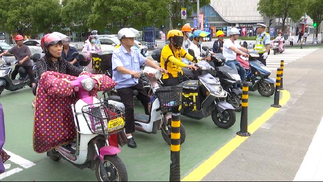 小细节大文明 文明有序交通在路上 北仑设非机动车二次过街等待区
